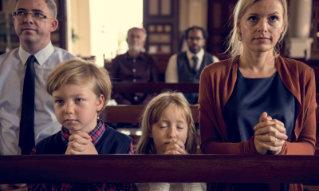 family attending a mass