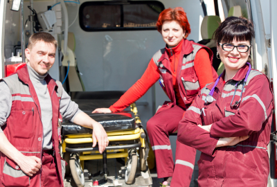 paramedic professional female with co-worker colleague on ambulance